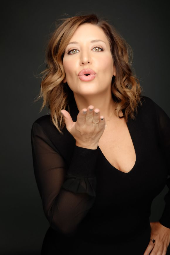 Nicci Levy blowing a kiss