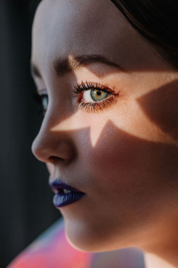 Woman with star light on her eye