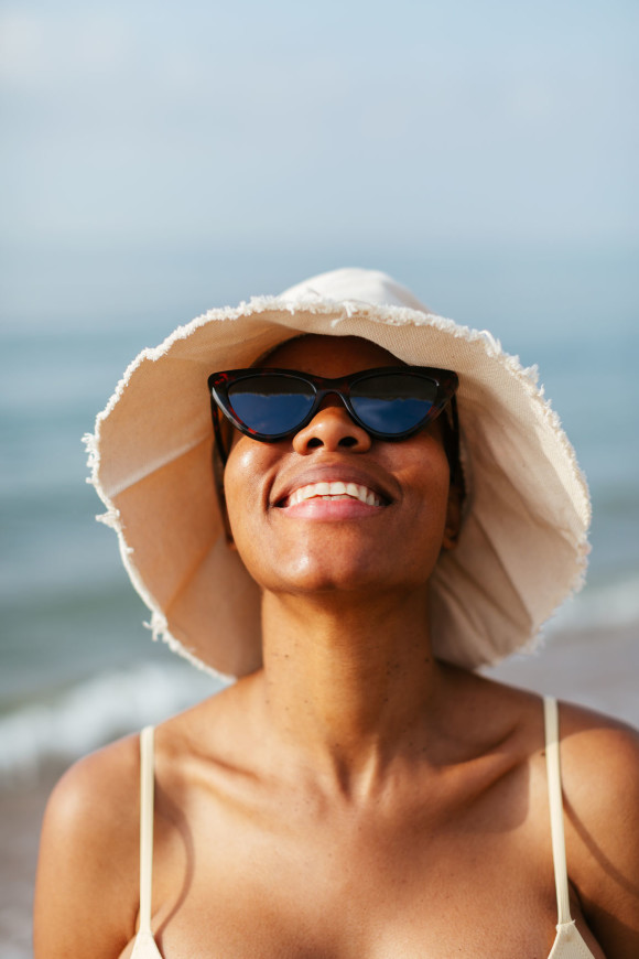 Black woman in sunglasses smiling