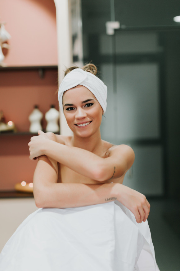 Woman in spa with towel on her head