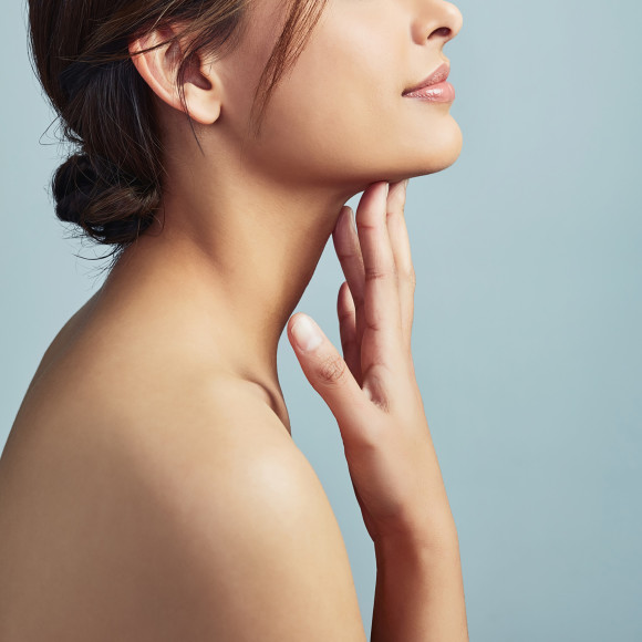 Woman touching her face and neck