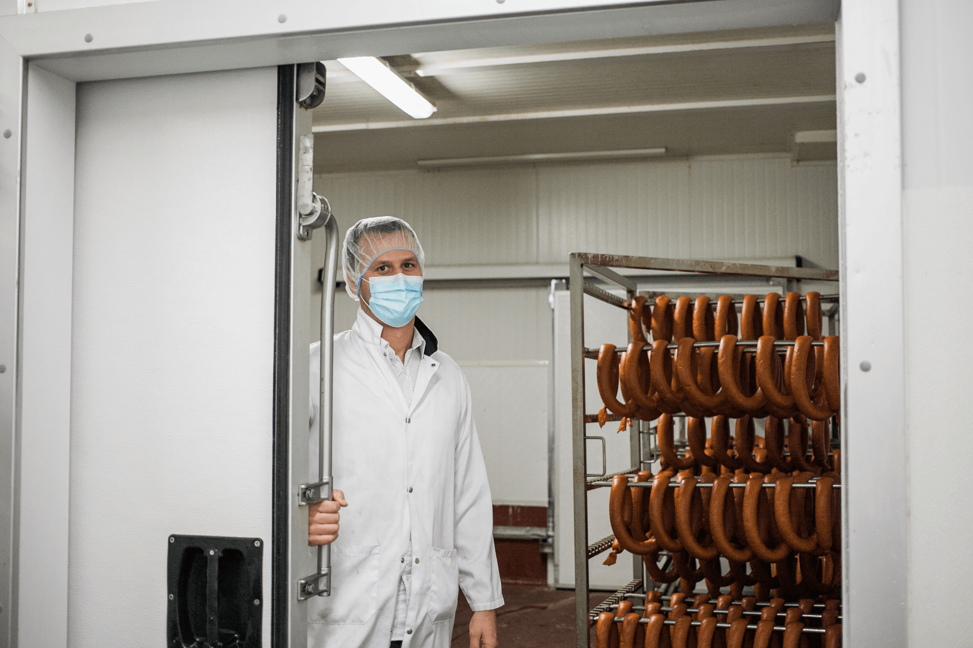 owner standing with sausages