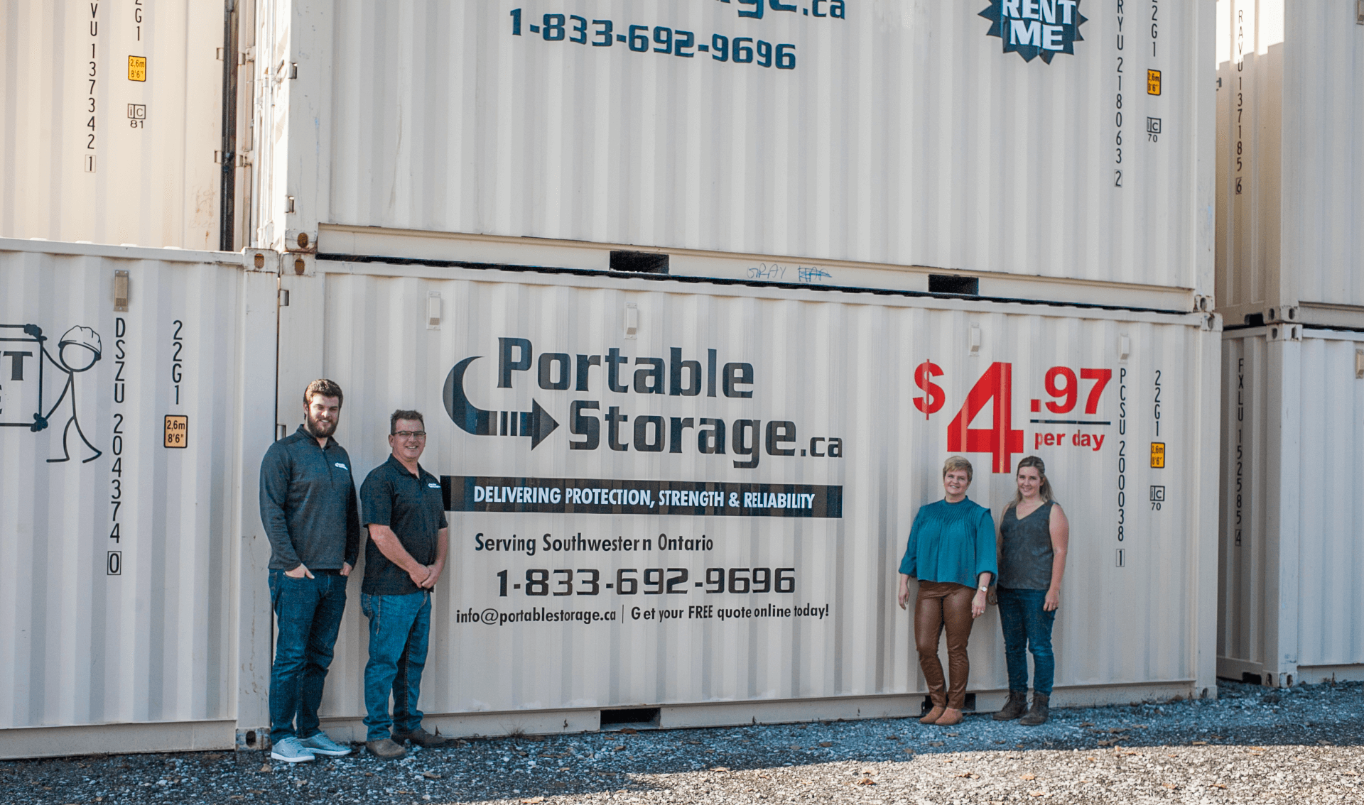 owners standing in front of shipping containers
