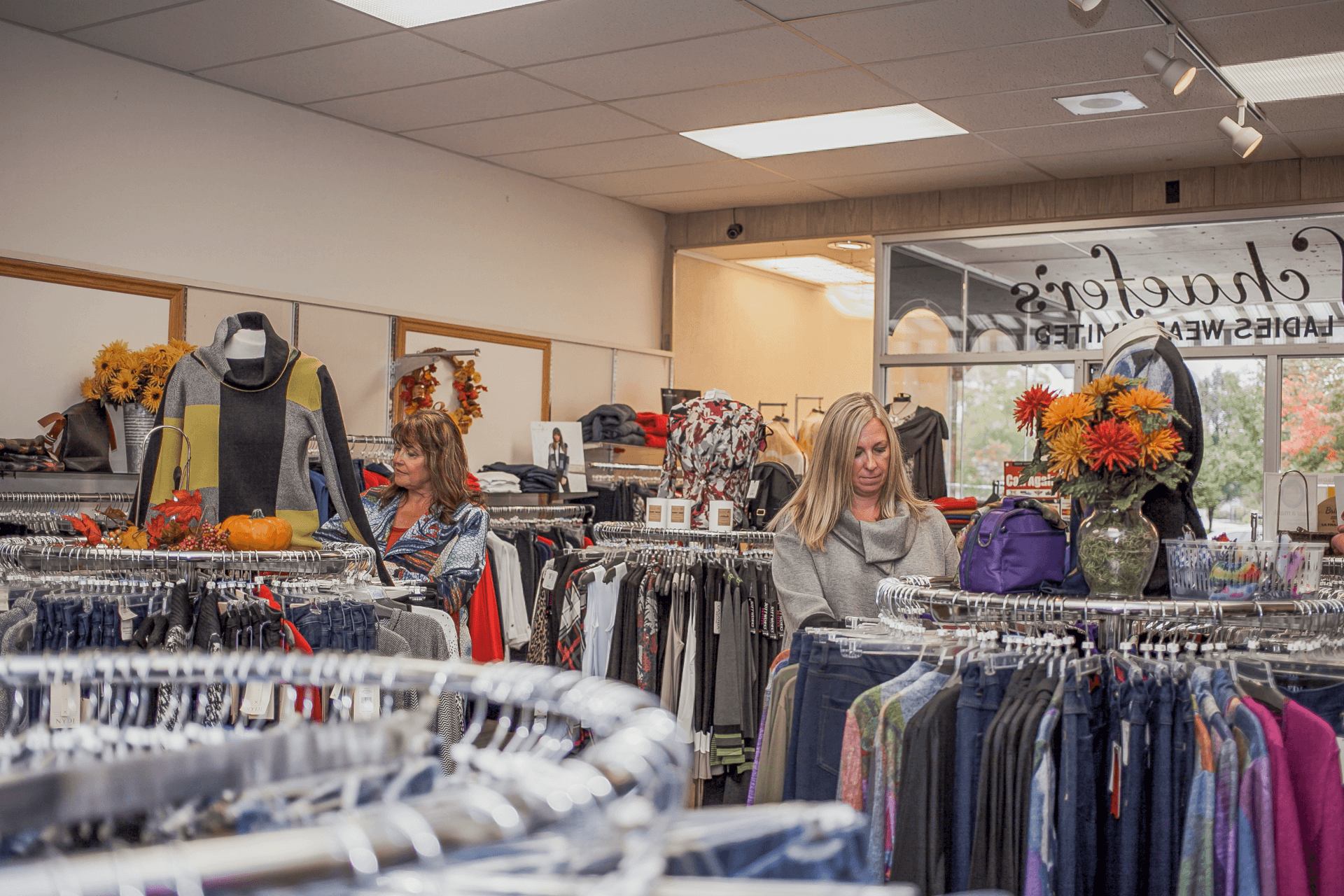 owner and employee sorting clothes