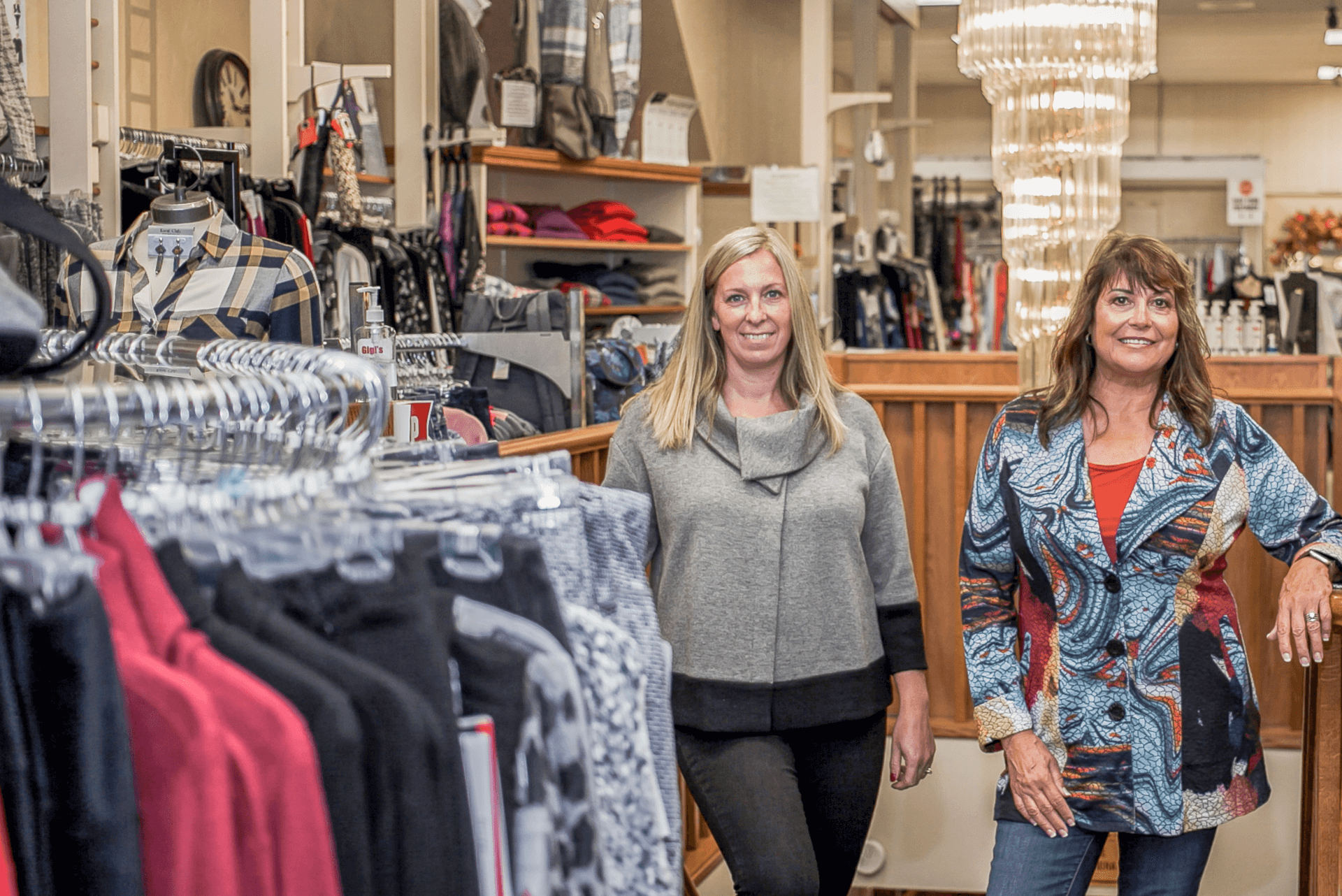owner and employee standing in clothing store