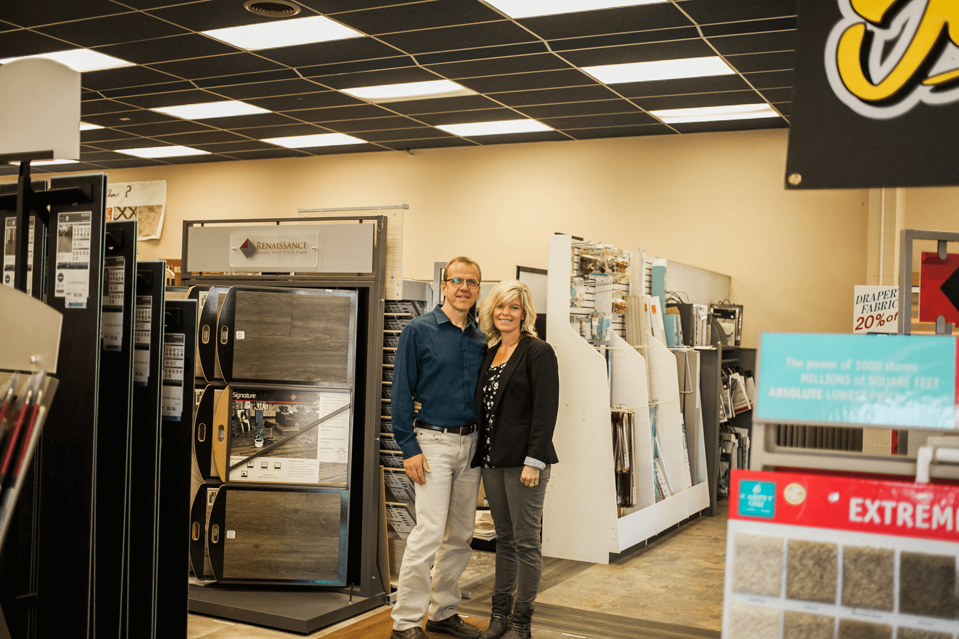owners standing near carpet samples