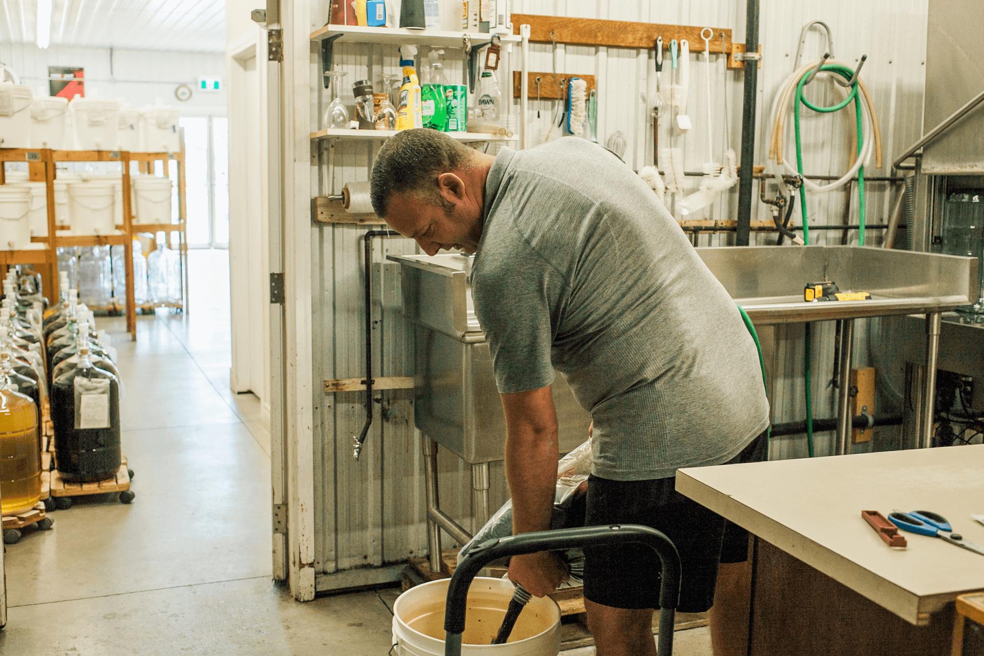 owner making wine