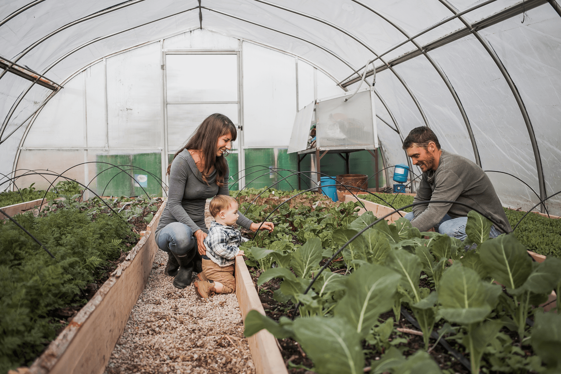 owners with son tending to garden