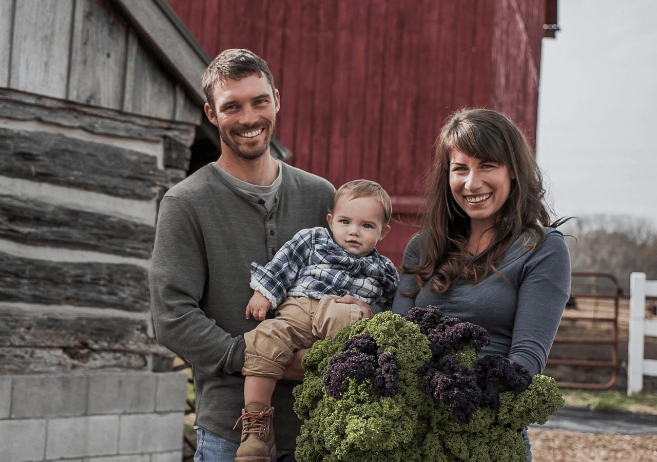 family holding kale