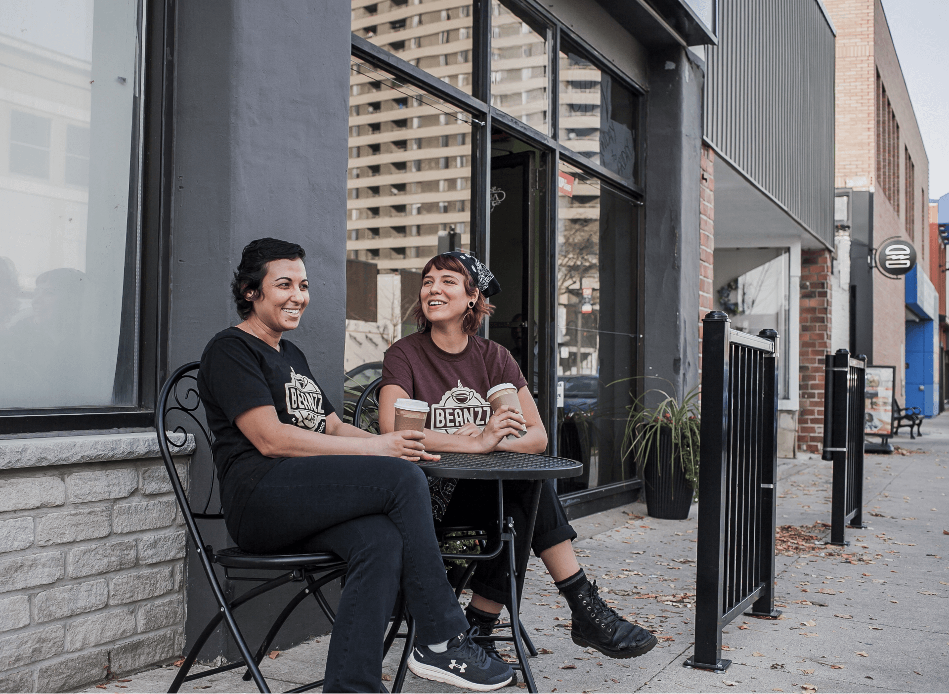 cafe owner and employee outside