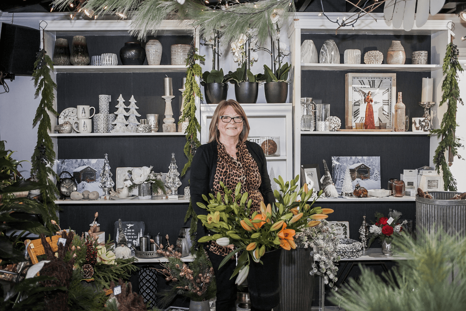 owner standing in front of seasonal decor
