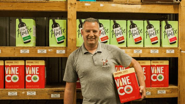 owner holding wine box