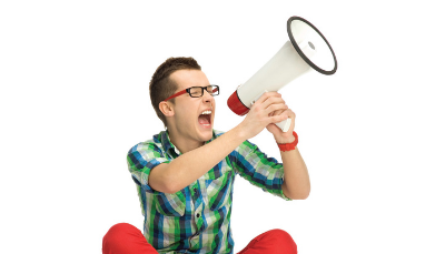man yelling into a microphone