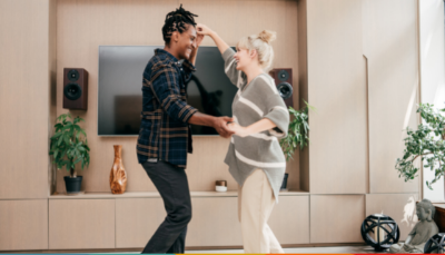 A couple dancing in living room