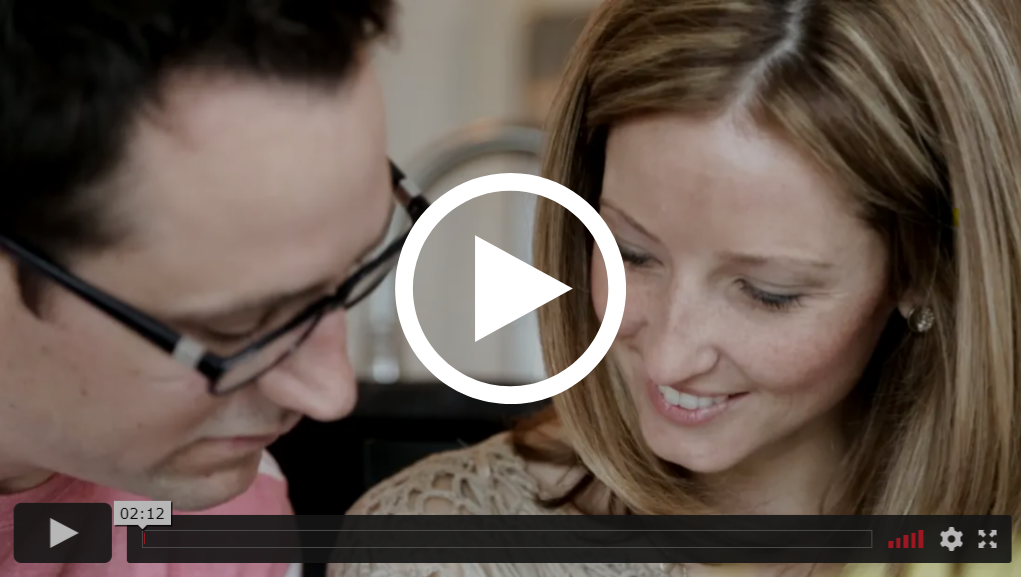 video still of couple standing in kitchen