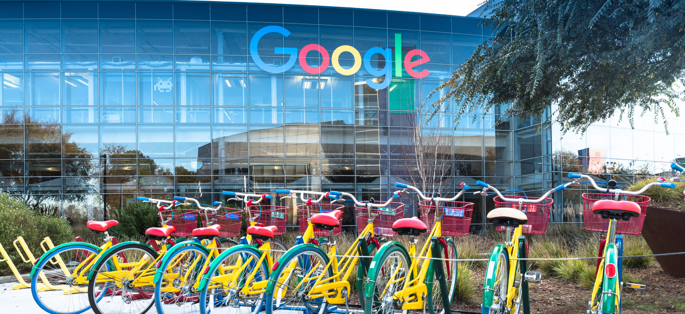 photo - Exterior of Google with colorful bikes lined up