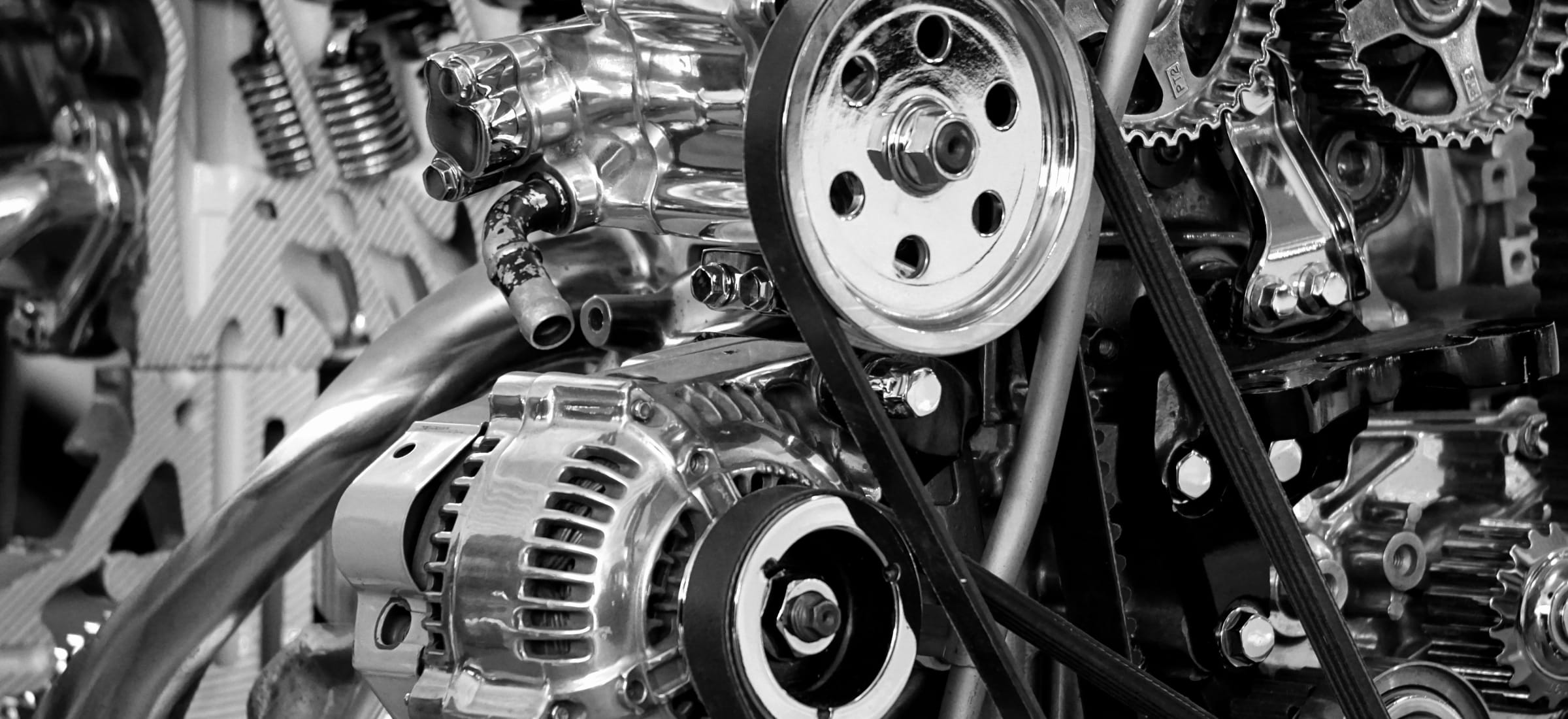 photo - Black and white photo of gears in a machine
