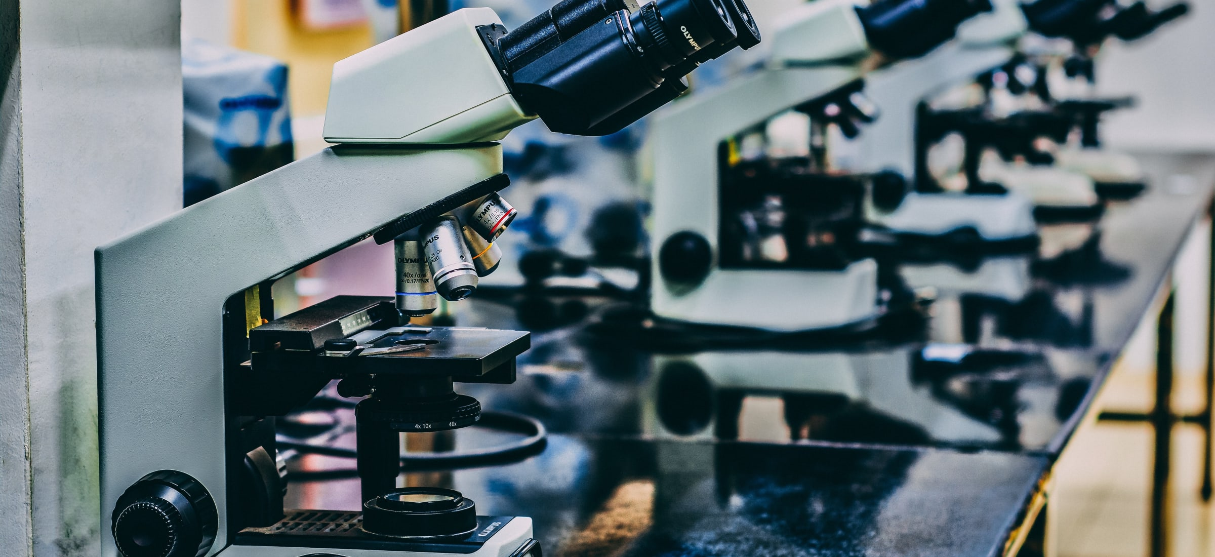 Microscopes in a line on a table