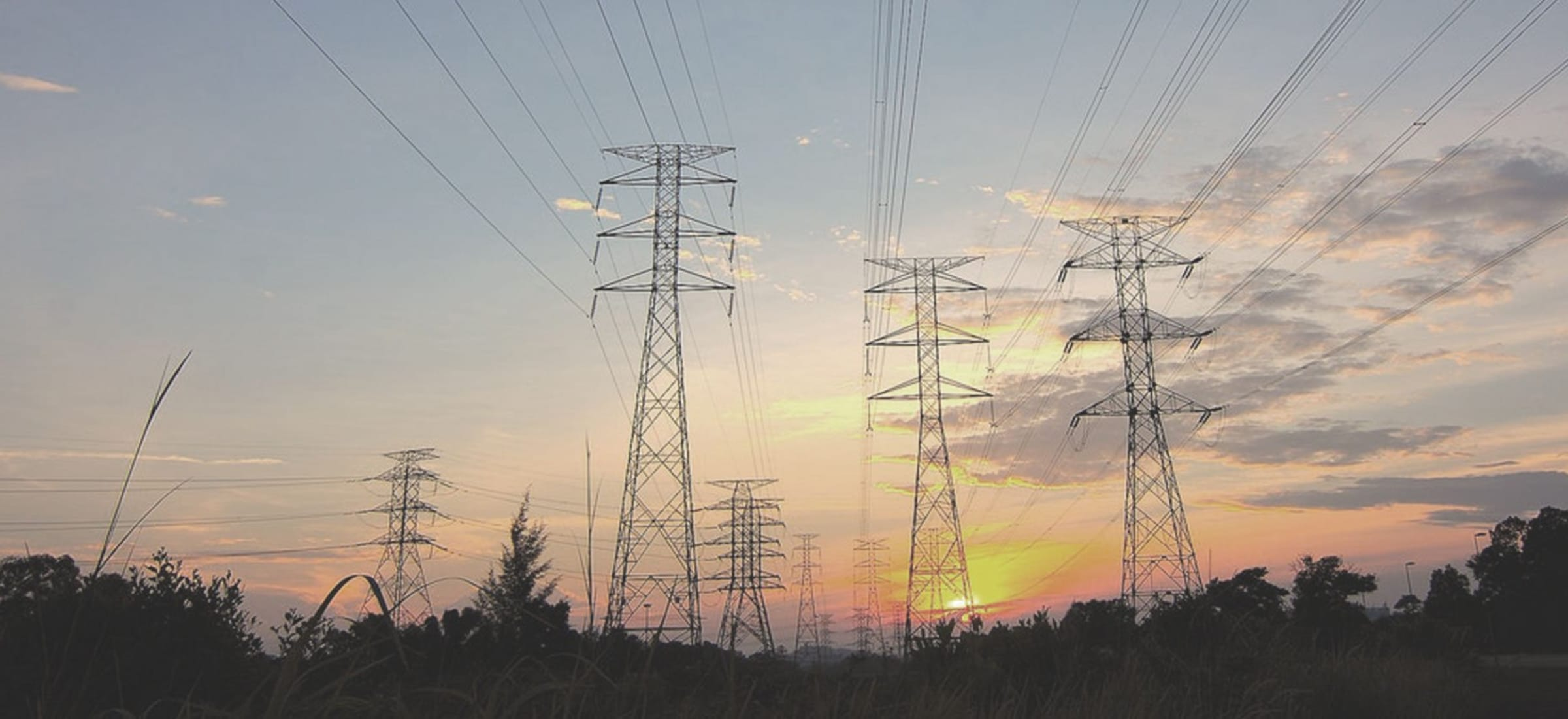 banner - power lines with a sunset in the background