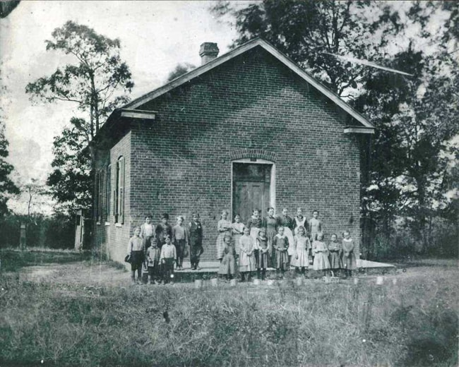 Schoolhouse with students in the 1890s