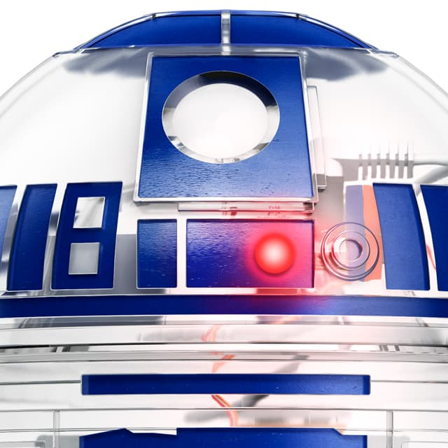 Starwars R2D2 by Littlebits, front close up with red light on, case transparent and blue stickers