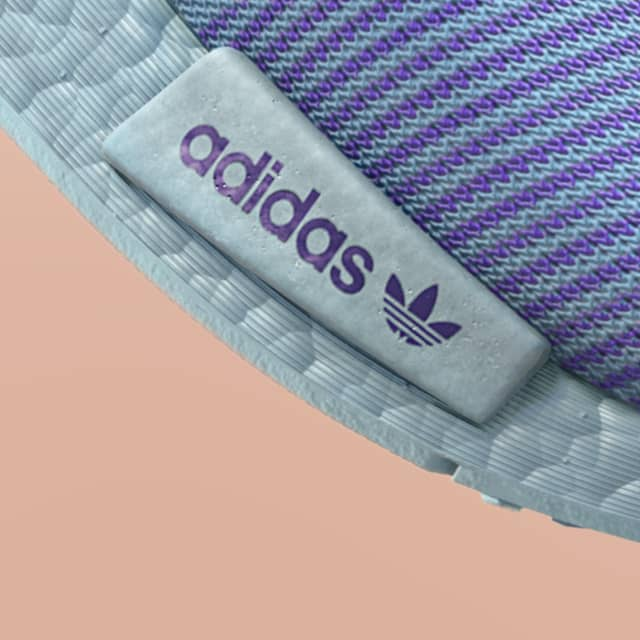Adidas Prime Knit close up of the purple and litght blue mesh and light blue outsole with background peach