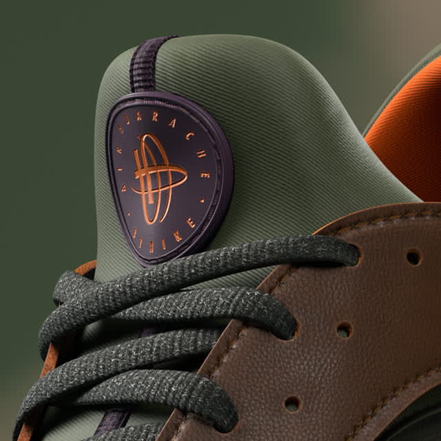 Huarache Nike sneaker tongue and laces with green and brown leather. Logo in orange