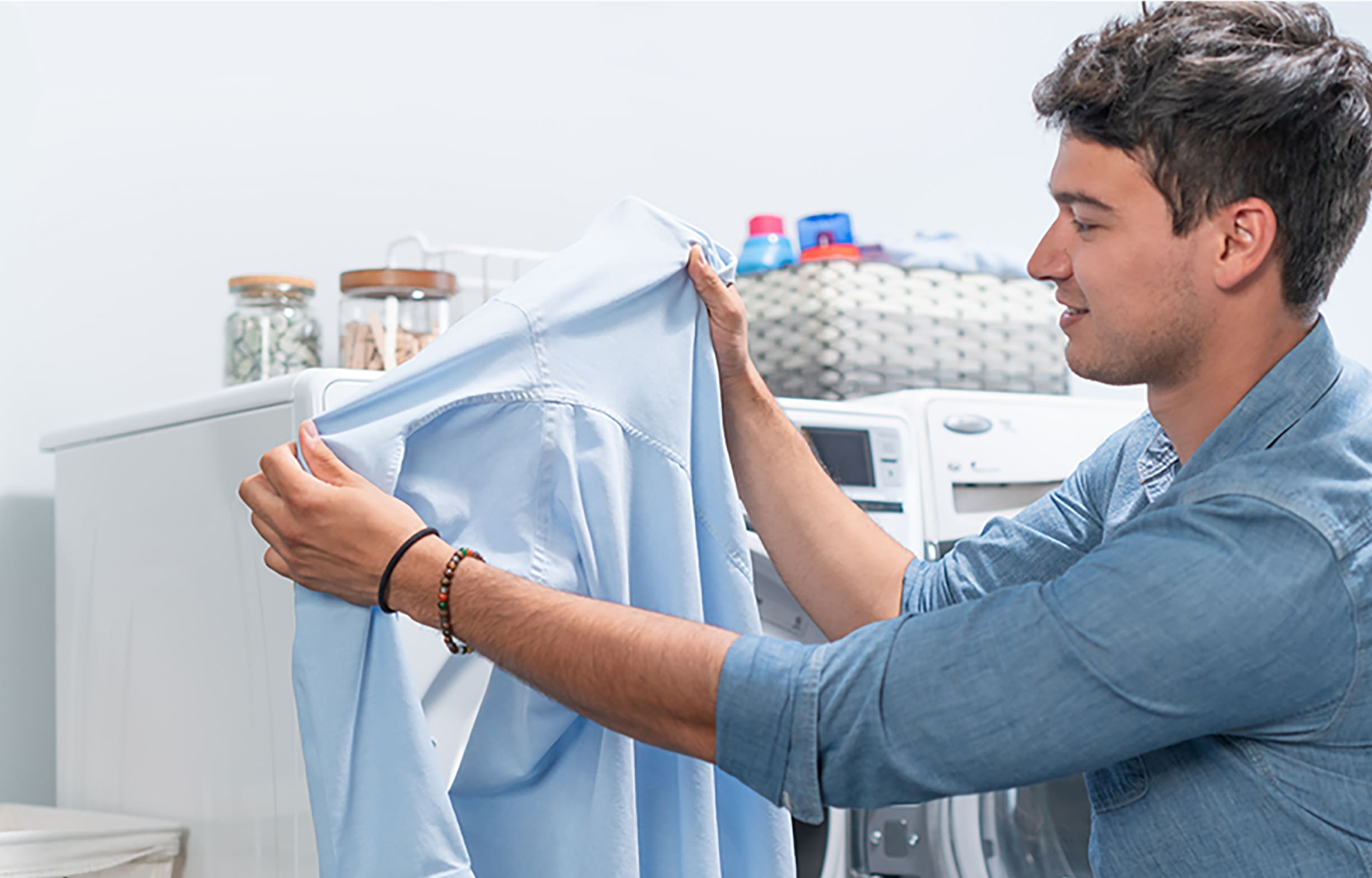 Man looking at a clean shirt after washing