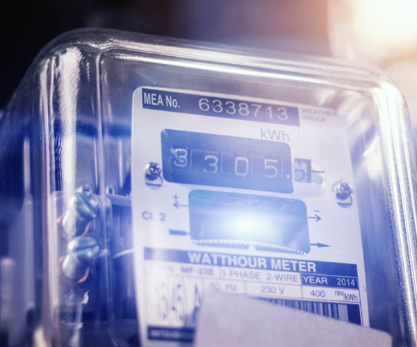 An image of an energy meter showing savings when using an HE washing machine.