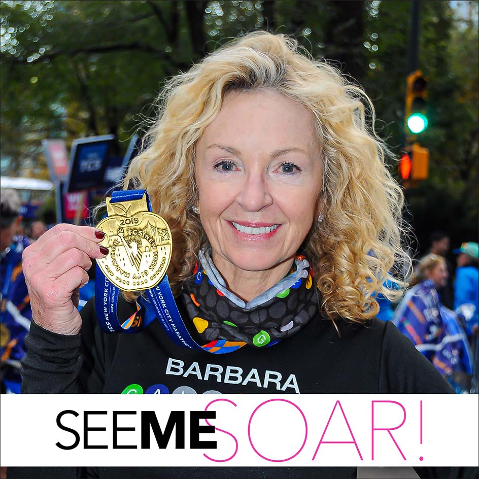 barbara hannah, author & activist with her medal after her New York marathon race