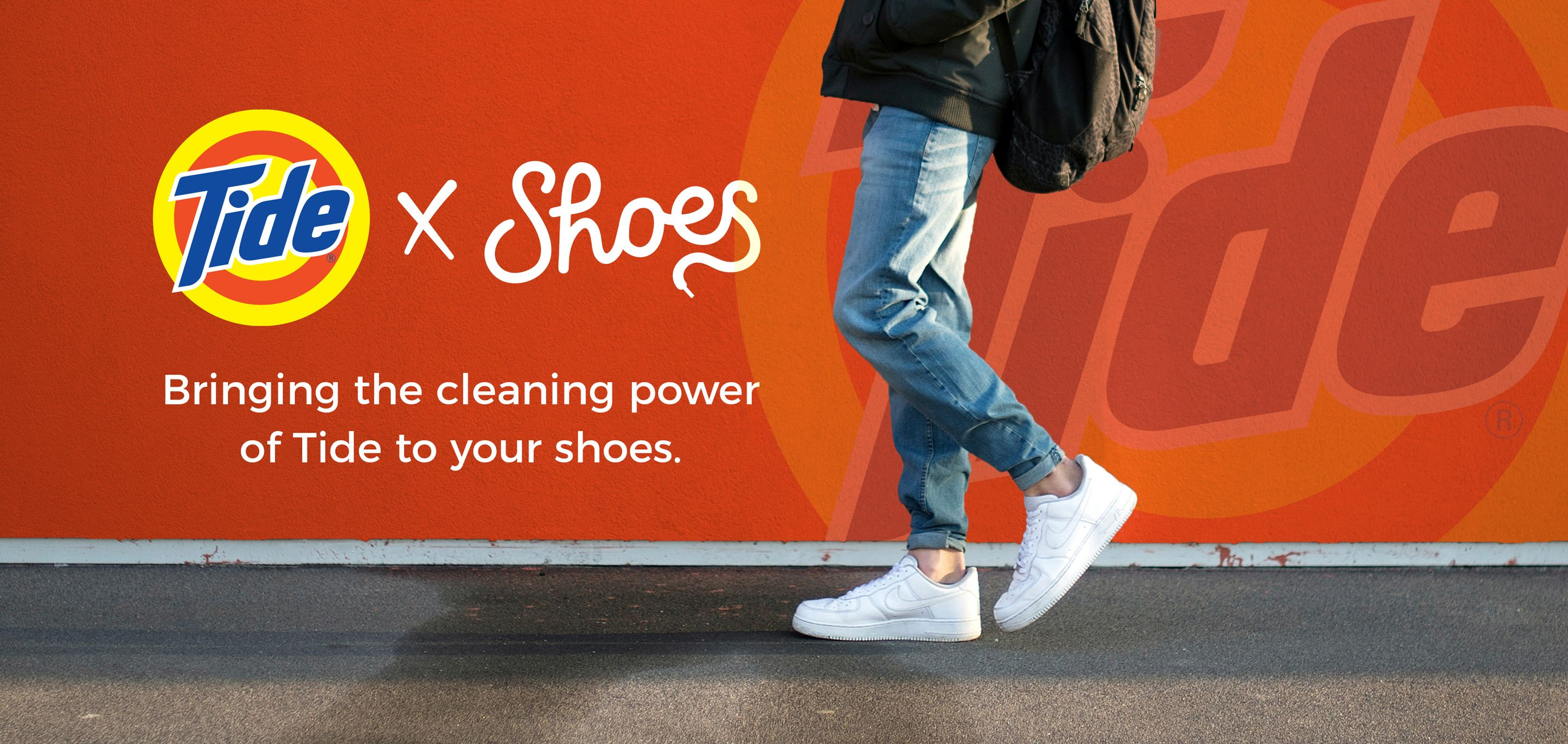 Man walking ion the street in front of a sing saying Bringing the cleaning power pf tode to your shoes