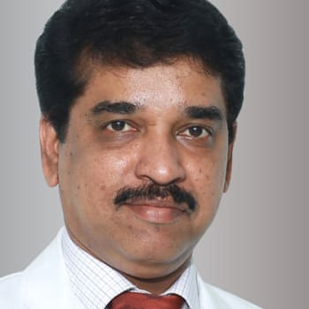 Dentist in Ernakulam  -  Dr. Santhosh John K A