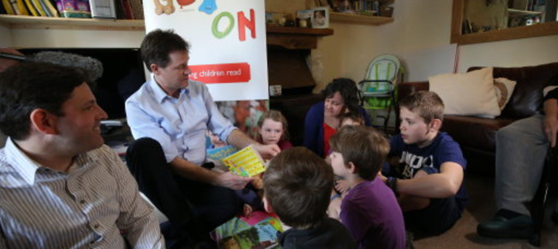 Nick Clegg reads a book to children