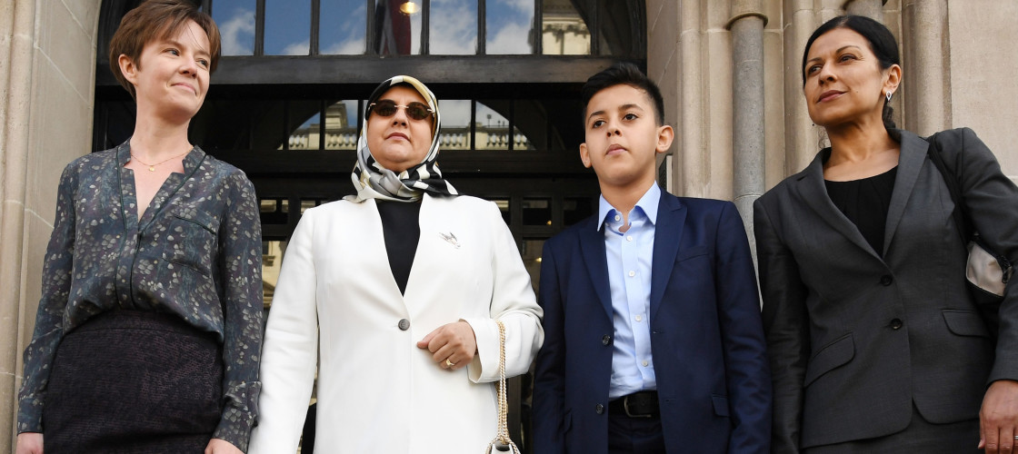 Fatima Boudchar and her son Abderrahim Belhaj, 14, with lawyers (far left) Cori Crider and (far right) Sapna Malik from Reprieve as they arrive at the Houses of Parliament in London.
