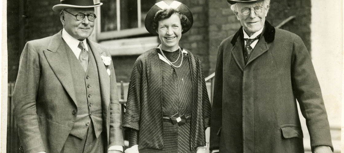 Frances Davidson takes her seat as the 33rd ever woman MP in 1937, alongside her husband J. C. C. Davidson, left, and Sir Willoughby Dickinson, right