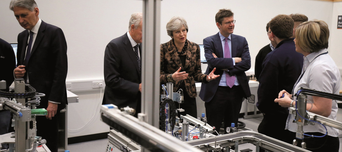 Theresa May, Philip Hammond and Greg Clark visit an engineering training facility in the West Midlands ahead of the Industrial Strategy launch