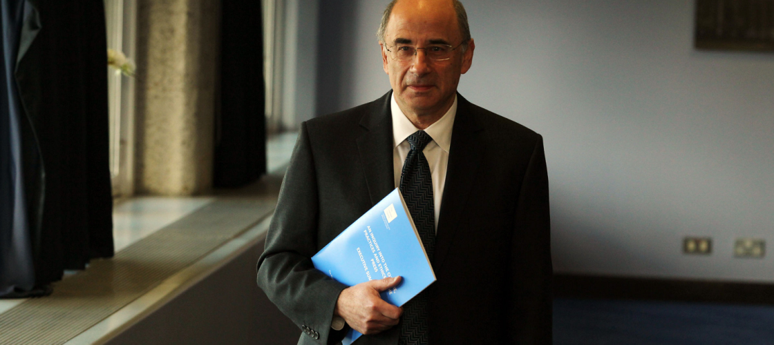 Brian Leveson with a copy of part one of his inquiry