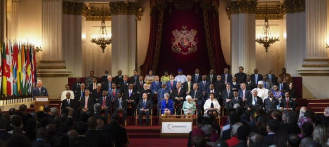 Her Majesty Queen Elizabeth II (centre right) and British Prime Minister Theresa May together with heads of CHOGM member states attend the formal opening of the Commonwealth Heads of Government Meeting in the Ballroom of Buckingham Palace in London