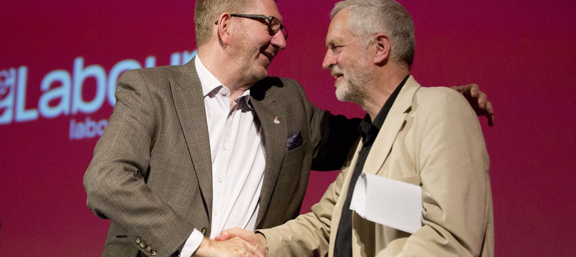 Jeremy Corbyn and Len McCluskey shake hands on stage