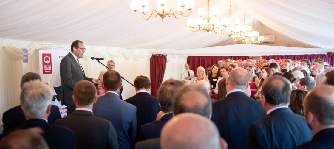 Construction Minister Richard Harrington speaks at FMB's event