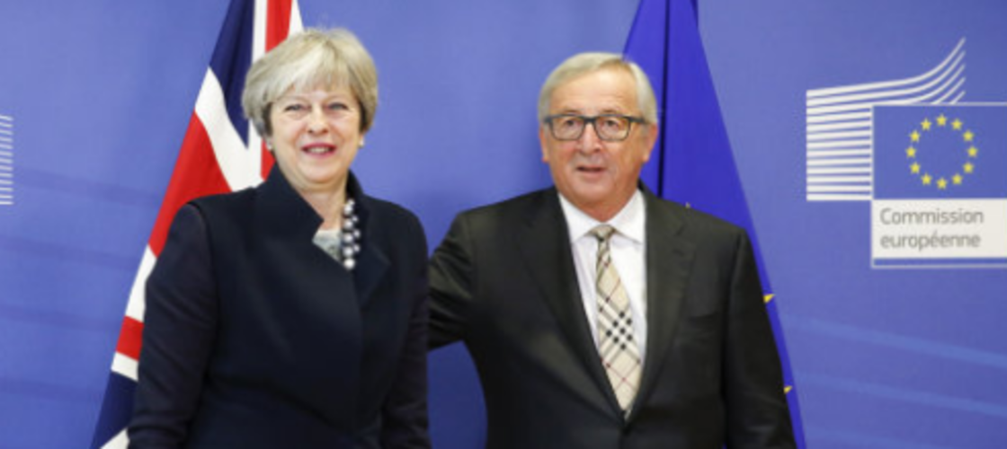 Theresa May and Jean-Claude Juncker before their meeting on Monday