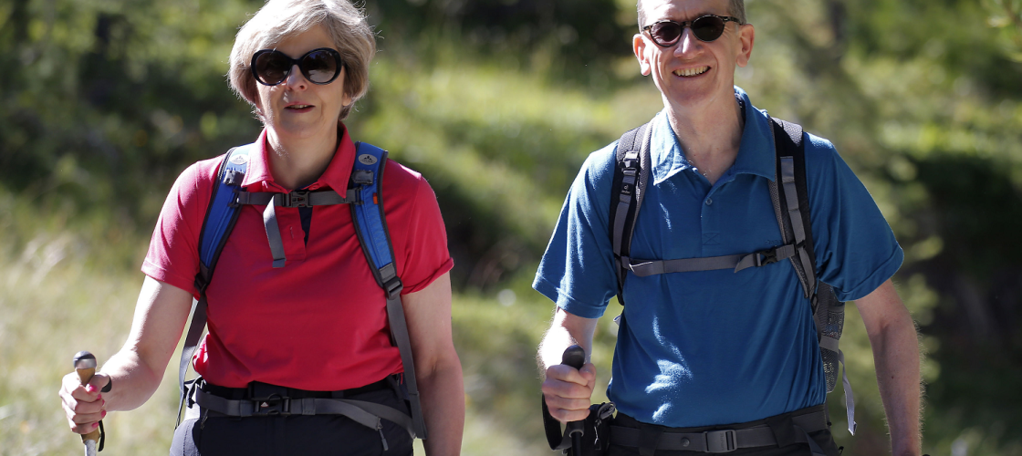 Theresa May and her husband Philip walking in Switzerland
