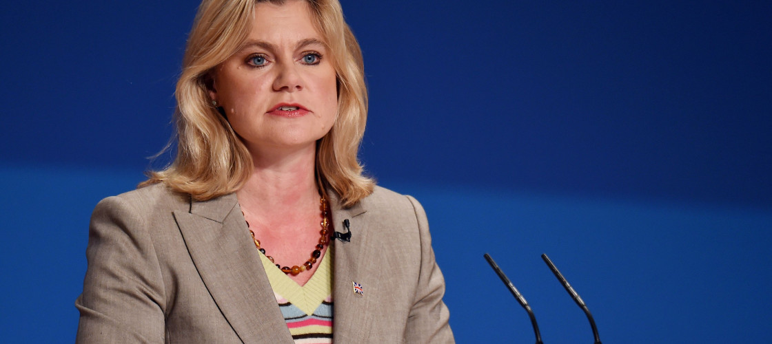 Justine Greening speaks at a podium