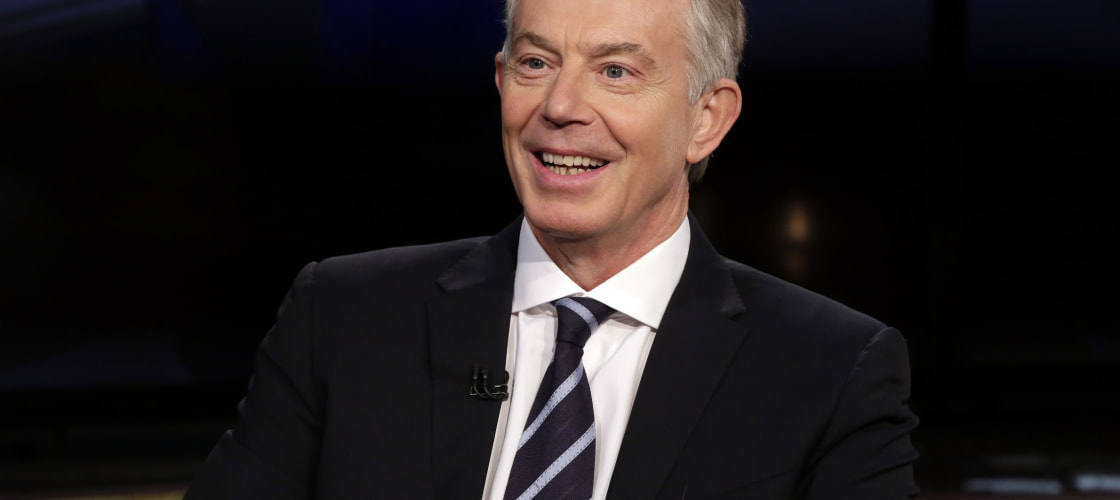 Tony Blair strongly defended his government's policy on EU immigration