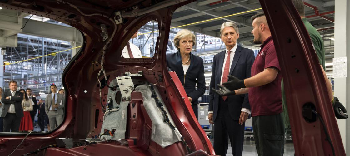 Theresa May and Philip Hammond at a car factory