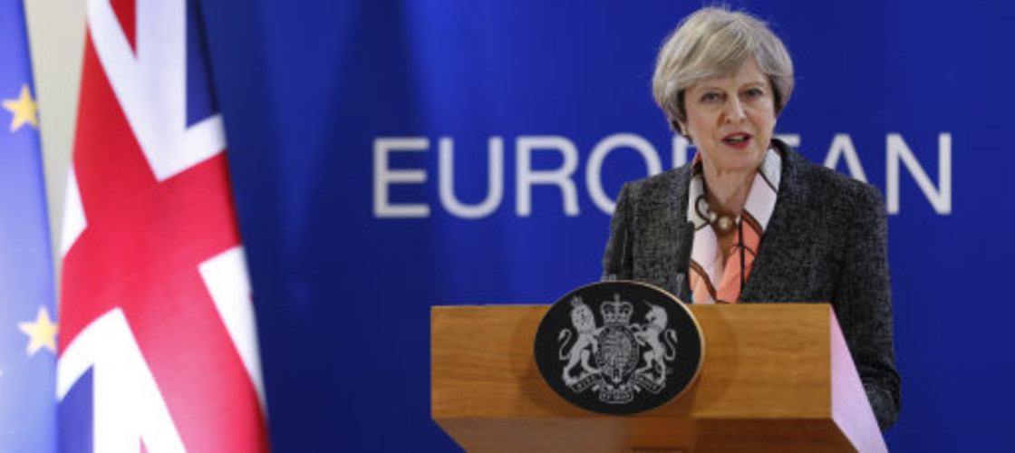 Theresa May speaking to reporters at the European Council on Thursday