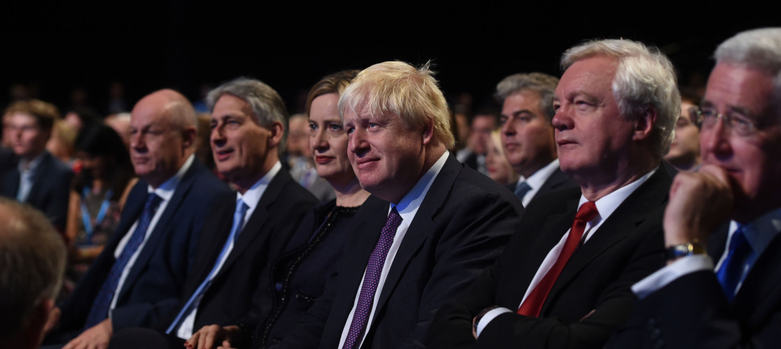 Boris Johnson flanked by Philip Hammond and David Davis at the Tory conference last year