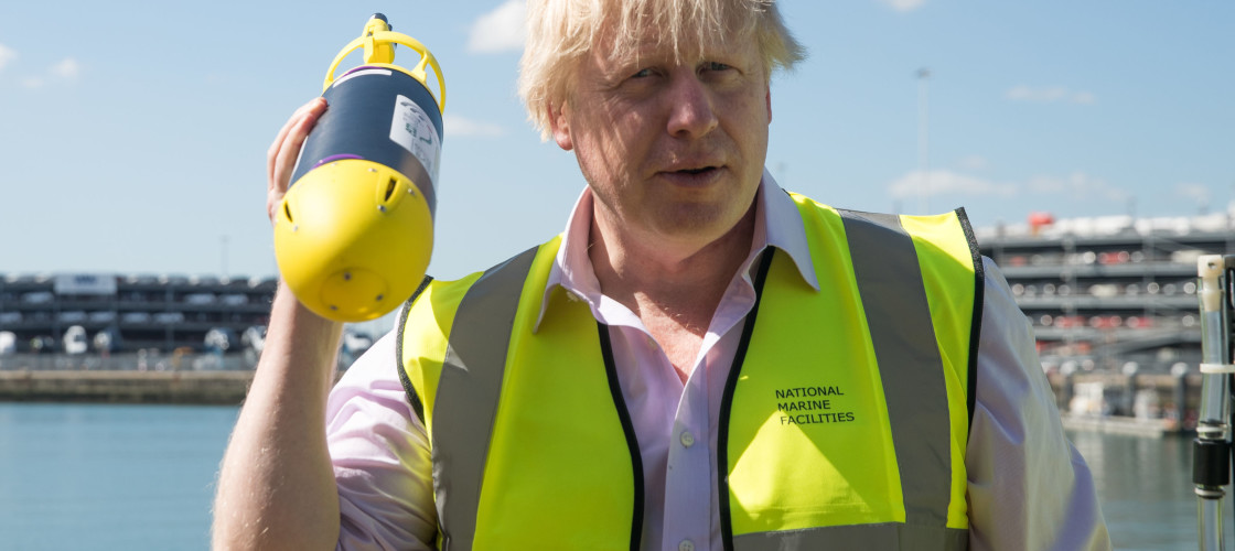 Foreign Secretary, Boris Johnson, holds a miniature autonomous submarine by ecoSUB robotics, during his visit to the National Oceanography Centre in Southampton ahead of the forthcoming FCO Oceans Strategy.