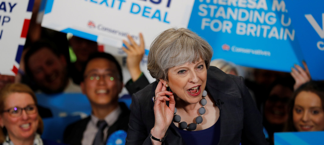 Britain's Prime Minister Theresa May reacts as she speaks at an election campaign event at Pride Park Stadium in Derby