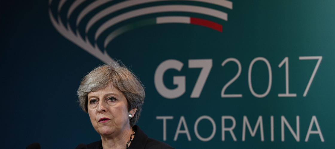 Theresa May at a press conference at the G7 conference in Sicily
